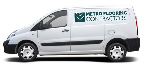 Metro Flooring Installer's White Vehicle