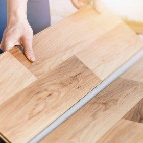Metro Flooring Contractors person installing hardwood flooring